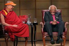 Nobel Peace Prize Laureate Archbishop Desmond Tutu, who has called for military intervention to topple the Mugabe government, with another bogus advocate of peace, the Dalai Lama.